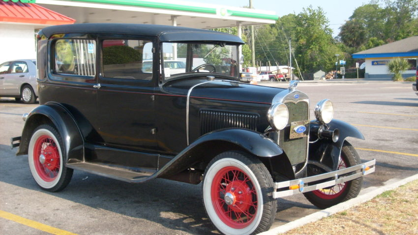 An antique car at a rest stop. I paused to photograph it, but i need to just keep going.
